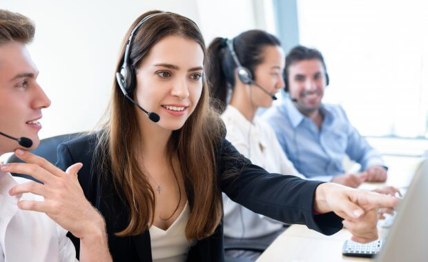 Businesswoman telemarketing staff working with new coworker team in call center officeBusinesswoman telemarketing staff working with new coworker team in call center office