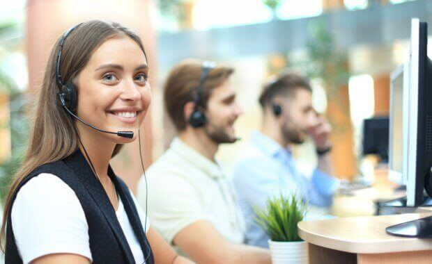 Positive young business people and colleagues in a call center office